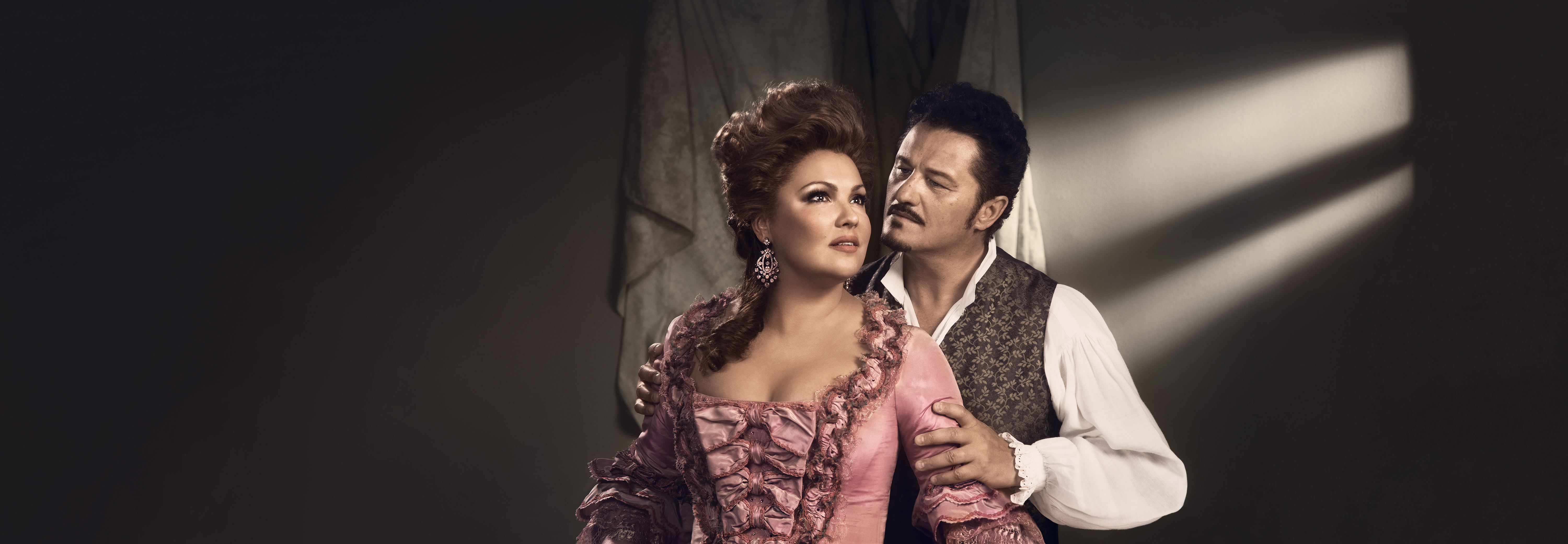 "Anna Netrebko and Piotr Beczała in ""Adriana Lecouvreur."" (Credit: Vincent Peters)"